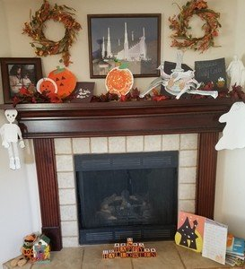 fireplace and mantle with Halloween decor